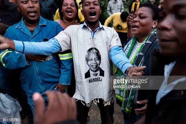 supporters react outside of the house of late South African antiapartheid campaigner Winnie MadikizelaMandela exwife of former South African...