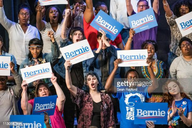 Supporters react to 2020 Democratic presidential candidate US Sen Bernie Sanders as he addresses the crowd at the Royal Family Life Center on March...