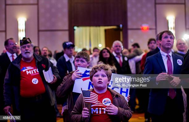 Supporters react to election results as Senate Minority Leader Mitch McConnell is declared the winner by cable news during a GOP victory party at the...