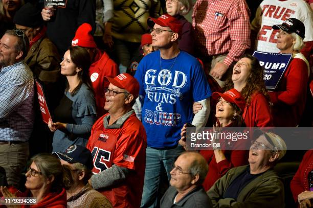 """Supporters react to President Donald Trump during a """"Keep America Great"""" campaign rally at BancorpSouth Arena on November 1, 2019 in Tupelo,..."""