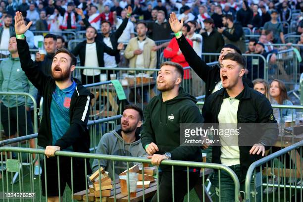 Supporters react to the big screen at the 4TheFans Fan Park at Event City in Manchester on June 18, 2021 in Manchester, England. England v Scotland...