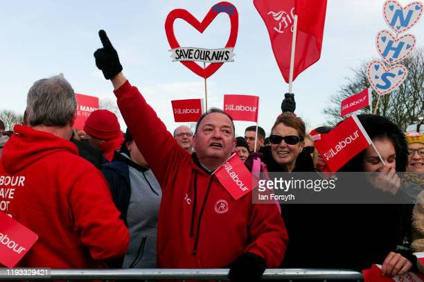 Supporters react to the speeches during a stump speech by party leaderJeremy Corbyn at the Sporting Lodge Inn on December 11 2019 in Middlesbrough...