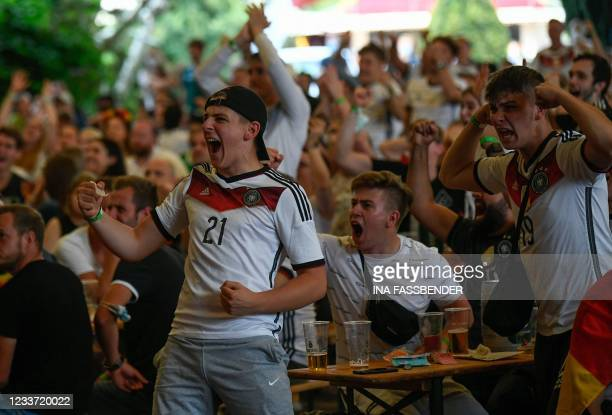 Supporters reacts after German goalkeeper Manuel Neuer made a save at the end of the first half of the UEFA EURO 2020 round of 16 football match...