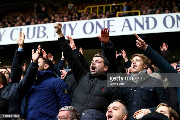 Supporters reacts after Harry Kane of Tottenham Hotspur scores his team's second goal during the Barclays Premier League match between Tottenham...