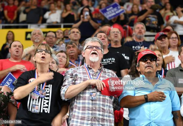 Supporters recite the Pledge of Allegience prior to US President Donald Trump speaking at a Make America Great Again rally at Freedom Hall Civic...