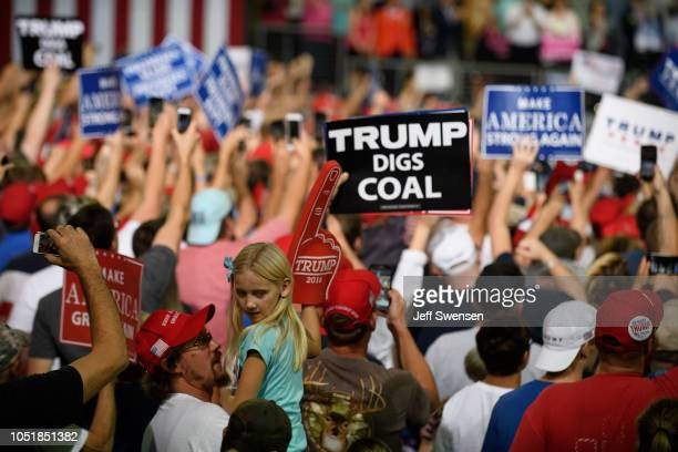 Supporters respond to a speech by US President Donald Trump at a rally at the Erie Insurance Arena on October 10 2018 in Erie Pennsylvania This was...
