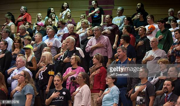Supporters say the Pledge of Allegiance before a rally for Republican candidate President Donald J Trump at Ambridge Area Senior High School on...