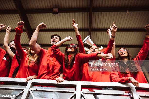 supporters screaming at the stadium - sports event stock pictures, royalty-free photos & images