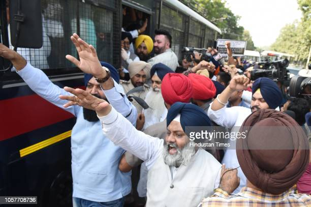 SAD supporters seen courting arrest during a protest outside the residence of Punjab Chief Minister Amarinder Singh against alleged denigration of...