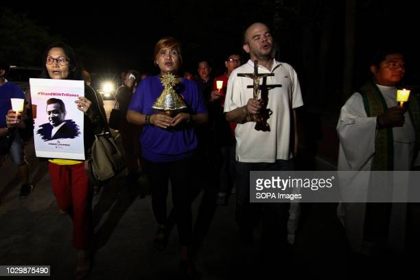 Supporters seen holding a cross and a poster of the Senator during the prayer mass Supporters of Senator Antonio Trillanes IV led by Fr Robert Reyes...