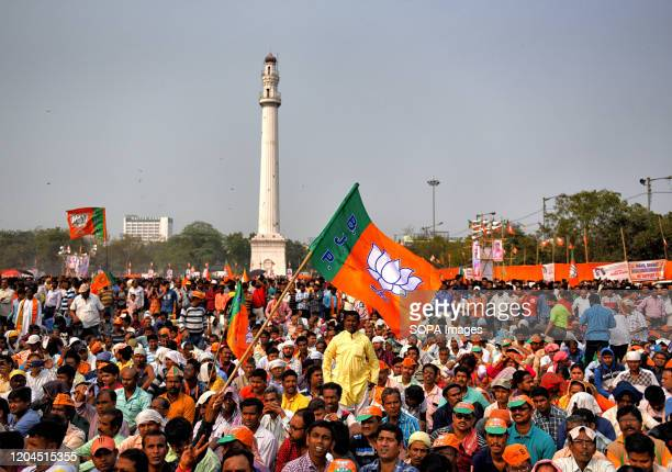 Supporters seen holding BJP flag listening to speeches during the CAA Support rally in kolkata.