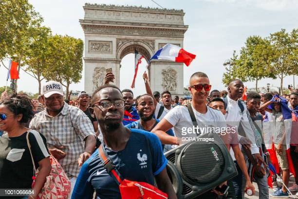 Supporters seen with huge speaker while celebrating the victory of France in the world cup. Thousands of supporters gathers at Champs Elysée to...