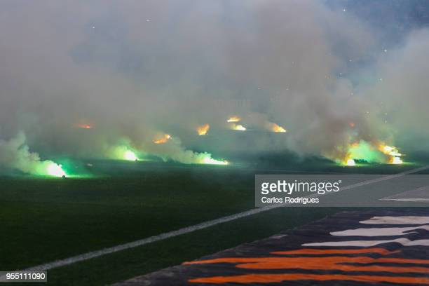 supporters send fireworks to the pitch during the Portuguese Primeira Liga match between Sporting CP and SL Benfica at Estadio Jose Alvalade on May...