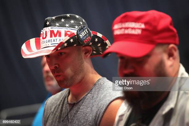 Supporters shop for campaign merchandise before the start of a rally with President Donald Trump on June 21 2017 in Cedar Rapids Iowa Trump is...