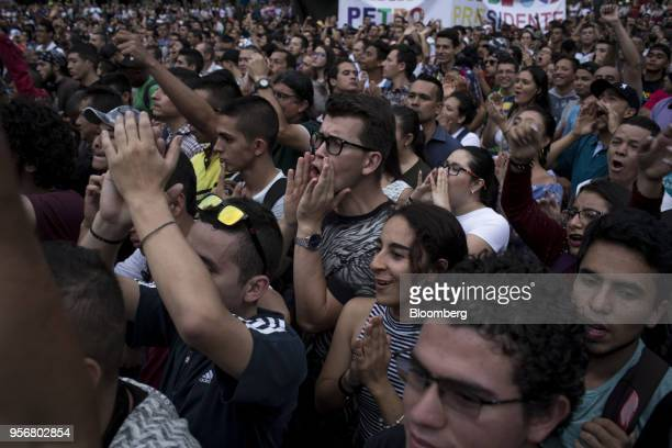 Supporters shout slogans as Gustavo Petro presidential candidate for the Progressivists Movement Party holds a campaign rally in Pereira Colombia on...