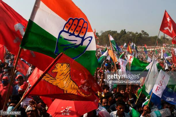 Supporters shout slogans as they attend a joint rally of the Congress, Left and Indian Secular Front parties ahead of the state legislative assembly...