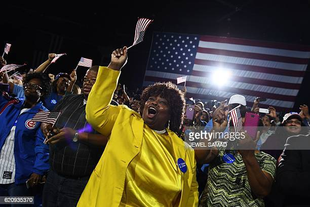 Supporters shout slogans as US Democratic presidential nominee Hillary Clinton speaks during a campaign rally in Raleigh North Carolina on November 3...