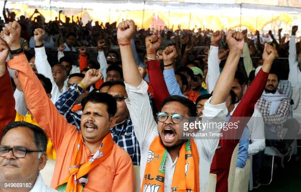 BJP supporters shout slogans during public rally by BJP Chief Amit Shah at GIC Ground on April 21 2018 in Rae Bareli India Taking his party's fight...