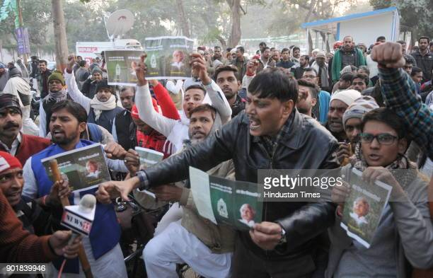 RJD supporters shouting slogans in support of Lalu Prasad at former CM Rabri Devi's residence during a press conference after Lalu Prasad was...