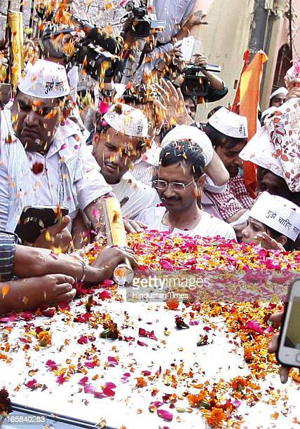 Supporters showering flowers on Aam Admi Party leader Arvind Kejriwal after he broke his 15 day old fast against inflated power and water bills at...
