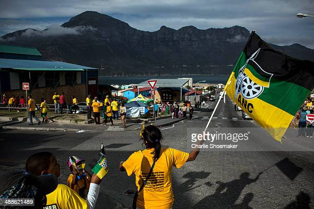 ANC supporters sing and dance outside of the Hangberg Sports and Recreation Centre voting station in the Hangberg community in Hout Bay on May 7...
