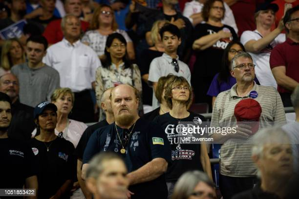 Supporters stand for the playing of the national anthem before a speech by US President Donald Trump at a rally at the Erie Insurance Arena on...