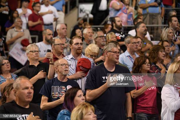 Supporters stand for the Pledge of Allegiance before a speech by US President Donald Trump at a rally at the Erie Insurance Arena on October 10 2018...