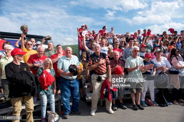 "Supporters stand for the Pledge of Allegiance before U.S. President Donald J. Trump held a ""MAGA"" rally at the Williamsport Regional Airport on May..."