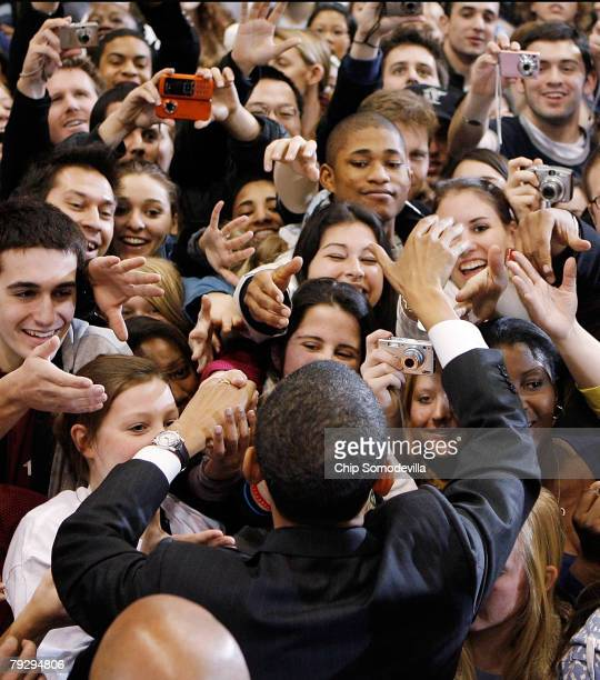 Supporters surge forward to shake hands with Sen Barack Obama during a rally in the Bender Arena at American University January 28 2008 in Washington...