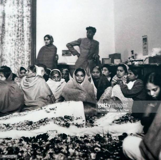 Supporters surround the body of Gandhi before his cremation Mohandas Karamchand Gandhi in 1948 Accompanying the body to the cremation are Prime...
