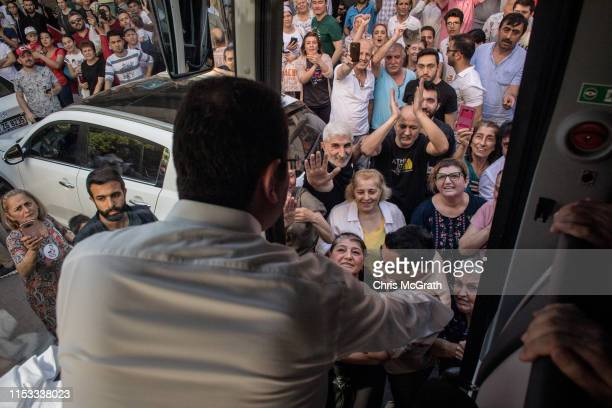 Supporters surround the bus of Ekrem Imamoglu CHP Party candidate for mayor of Istanbul as he arrives at a rally stop during campaigning in the rerun...