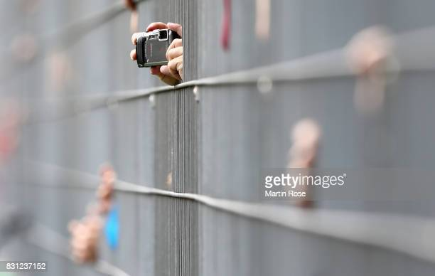 Supporters take a picture during the DFB Cup first round match between FC Eintracht Norderstedt and VfL Wolfsburg at EdmundPlambeckStadion on August...