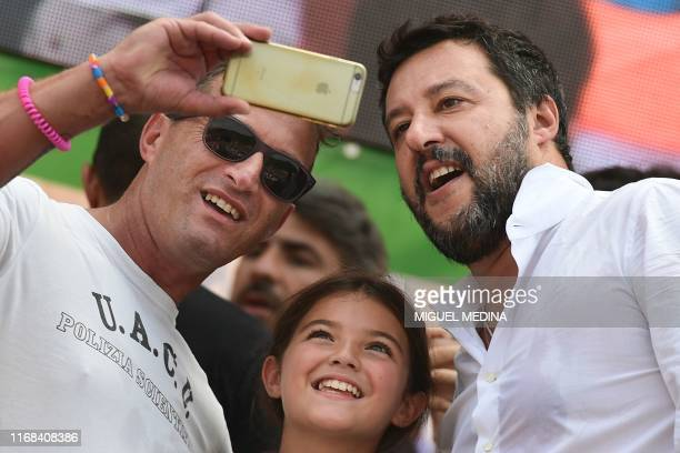 Supporters take a selfie photo with Italian senator head of the Italian farright League party Matteo Salvini on stage after he delivered a speech at...