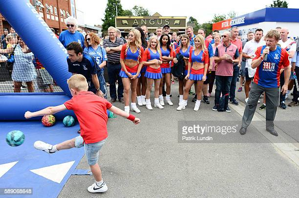 Supporters take part in a competition head of the Premier League match between Crystal Palace FC and West Bromwich Albion FC at Selhurst Park on...