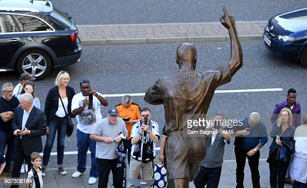 Supporters take photographs of the Alan Shearer statue during the Sky Bet Championship match between Newcastle United v Wolverhampton Wanderers at St...