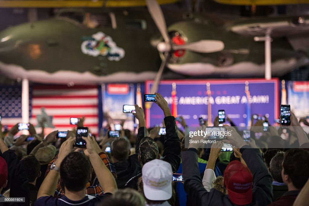 Supporters take photos as Republican presidential candidate Donald Trump speaks to the crowd Pearl Harbor Day Rally At USS Yorktown Monday, December 7, 2015, in Mt. Pleasant, South Carolina. The South Carolina Republican primary is scheduled for February 20, 2016.