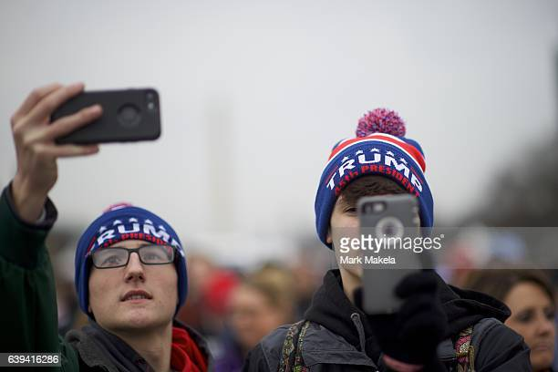 Supporters take photos with their smartphones during the inauguration of Donald Trump before he was sworn in as the 45th President of the United...