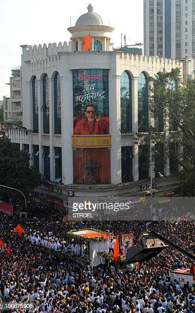 Supporters throng the funeral cortege of Indian Hindu nationalist Shiv Sena party leader Bal Thackeray during a procession in Mumbai on November 18...