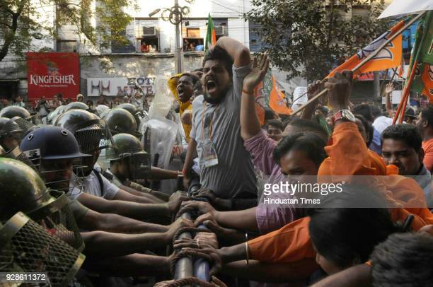 BJP supporters try to break police barricades during the protest rally against failure of Trinamool Congress govt to protect women safety on the eve...
