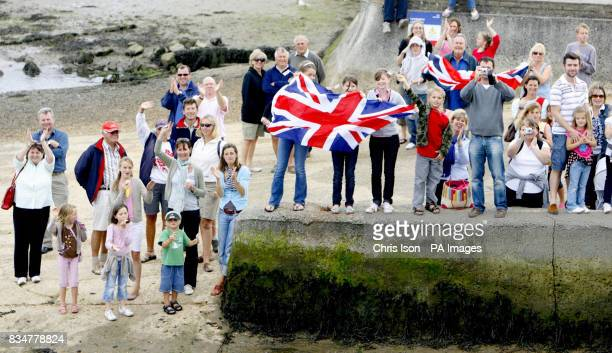Supporters turn out to greet British Olympic sailing medallist Ben Ainslie at the Royal Lymington Yacht Club in the New Forest after his triumphant...
