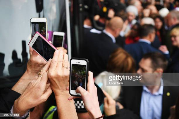 Supporters use their mobile phones to take photographers of leader of the Labour Party Jeremy Corbyn as he attends a campaign rally in Beaumont Park...