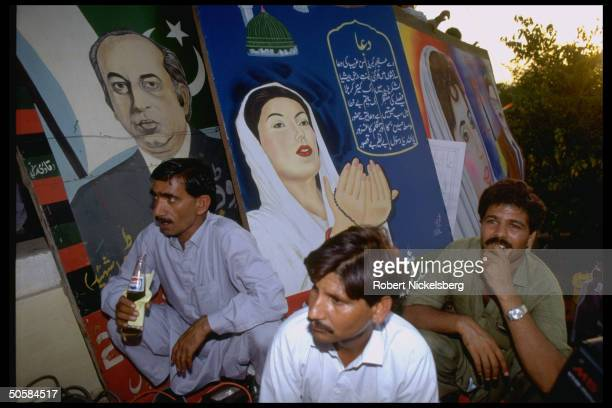 PPP supporters w portraits of Pakistan People's Party ldr Benazir Bhutto her father Zulfikar Ali at election campaign rally in Punjab