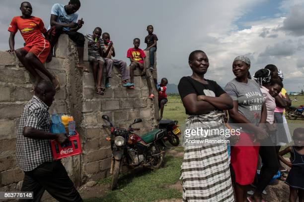 Supporters wait for a rally for opposition candidate Raila Odinga to begin at the Ogango Grounds on October 20 2017 in Kisumu Kenya Tensions are high...