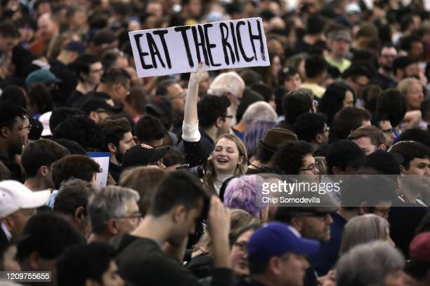 Supporters wait for Democratic presidential candidate Sen Bernie Sanders at a campaign rally at South Hall March 01 2020 in San Jose California...