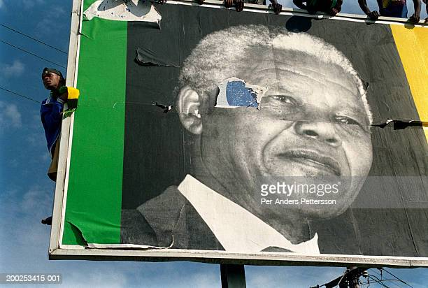 ANC supporters wait for President Nelson Mandelas motorcade to pass by during an election campaign on April 13 1994 in Durban South Africa Nelson...