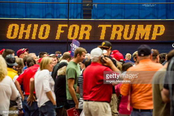Supporters wait for Republican presidential nominee Donald Trump to speak at a campaign rally at the James A Rhodes Arena on August 22 2016 in Akron...