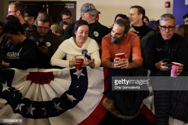 Supporters wait for results at a caucus night watch party for Democratic presidential candidate Sen Elizabeth Warren on February 03 2020 in Des...