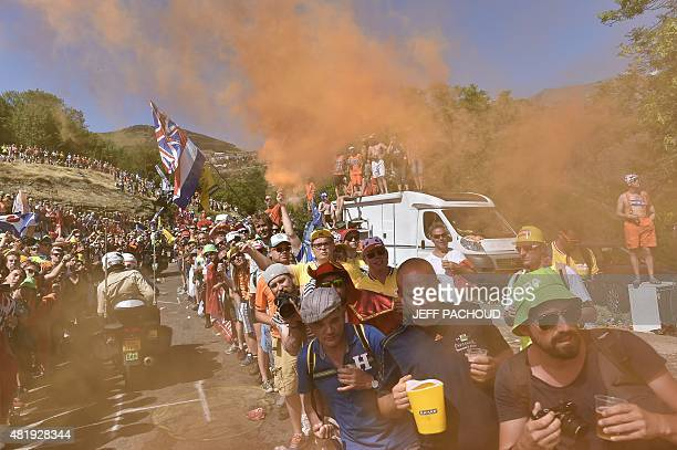 Supporters wait for riders along the road at the Dutch corner during the 1105 km twentieth stage of the 102nd edition of the Tour de France cycling...
