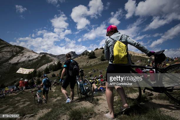 TOPSHOT Supporters wait for riders at the Col d'Izoard near the finish line during the 1795 km eighteenth stage of the 104th edition of the Tour de...