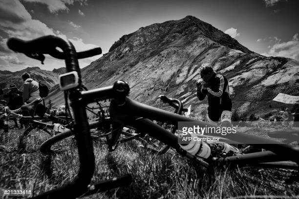 Supporters wait for riders at the Col d'Izoard near the finish line during the 1795 km eighteenth stage of the 104th edition of the Tour de France...